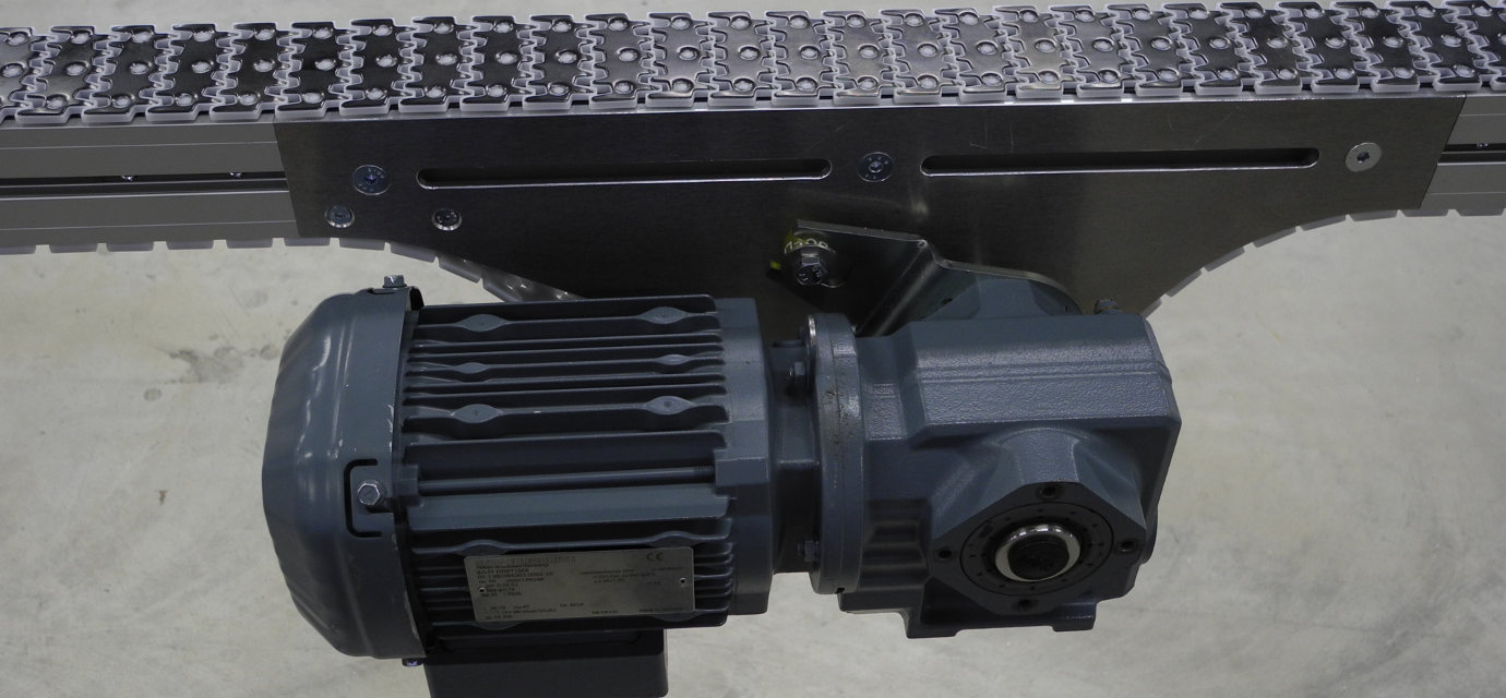 Mid drive unit for chain conveyor systems